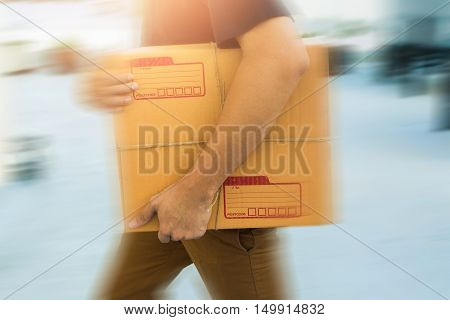 Delivery service holding to sent a package box.