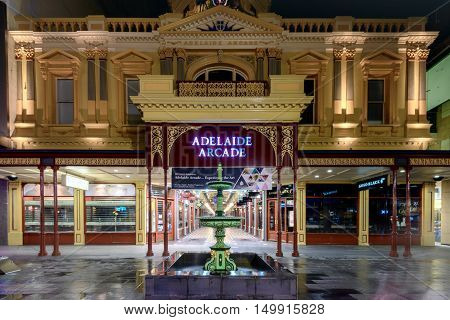Adelaide Australia - August 11 2015: Adelaide's famous Rundle Mall Arcade Building at night time under the rain during winter season