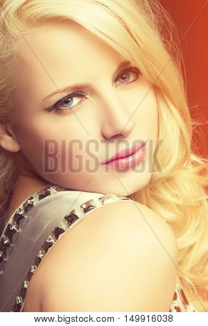 Portrait of pretty blond woman looking over shoulder