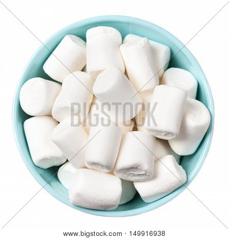 White Fluffy white marshmallows in blue bowl isolated on white background. Huge big marshmallow macro top view image