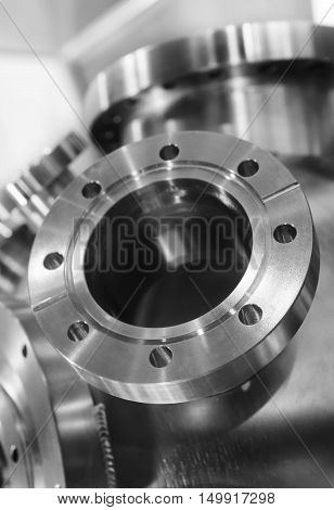 Industrial background, heavy metal housing with welded metal flanges. Shallow depth of field.