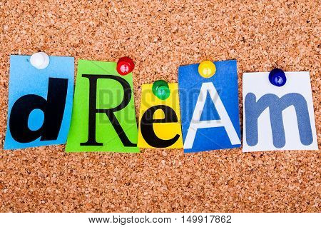 The Word Dream In Cut Out Magazine Letters Pinned To A Cork Notice Board..