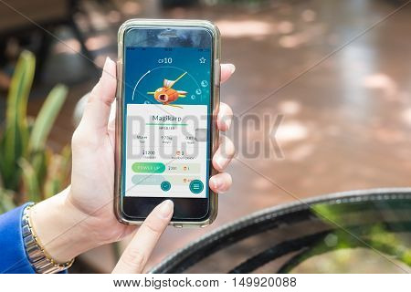 Nakhonratchasima THAILAND September 6 2016 : Pokemon Go app a free-to-play augmented reality mobile game developed by Niantic for iOS in public park THAILAND.
