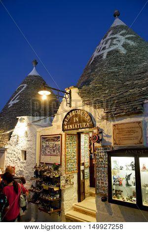 Alberobello Italy - August 14 2016: Shop in the trulli of alberobello at sunset