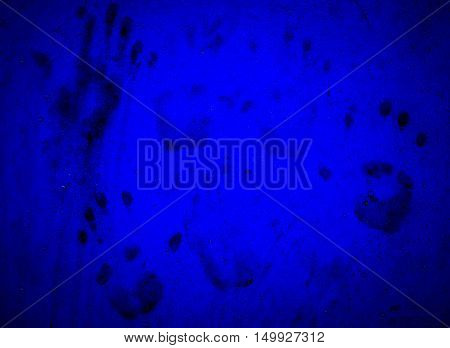 Dirty Hand prints on blue wall. Ideas for background Halloween