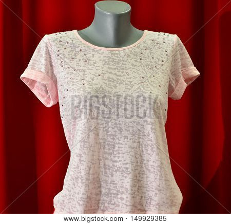 picture of a fashion summer clothes on a manequin doll on a red background