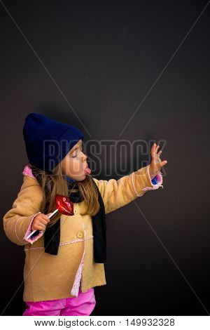 Beautiful Stylish Girl In A Black Background Of The Walls