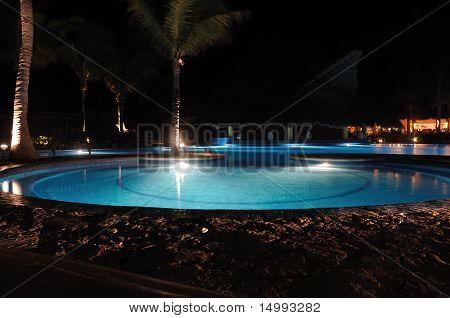 Tropical Resort Swimming Pool At Night