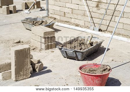 Construction site area for adobe (mud bricks) technique during daytime
