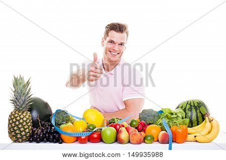 He Knows What's Good For You! - Handsome Muscular Man Sitting Behind A Table Full Of Vegetables And