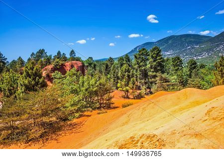 Picturesque red-orange hills of natural dye - ochre. The South of France, Languedoc - Roussillon