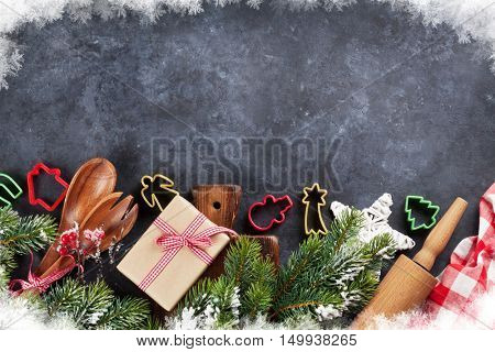 Christmas cooking utensils and snow tree on stone table. Top view with copy space