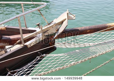 Detailed view of a yacht anchor in an harbour