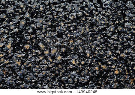 Background of new and fresh black asphalt tar