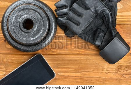 Weight Plates, Gloves And Smartphone