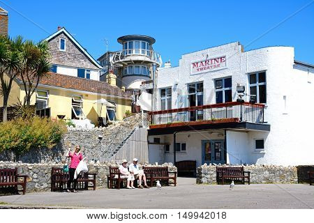 LYME REGIS, UNITED KINGDOM - JULY 18, 2016 - View of the Marine Theatre at Gun Cliff Walk with tourists enjoying the setting Lyme Regis Dorset England UK Western Europe, July 18, 2016.