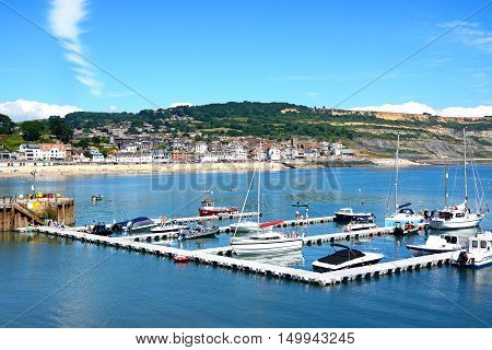 LYME REGIS, UNITED KINGDOM - JULY 18, 2016 - Yachts moored at the pontoon with views towards the beach and town Lyme Regis Dorset England UK Western Europe, July 18, 2016.