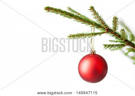 Christmas celebration holiday background with copyspace - Christmas-tree decoration bauble on decorated Christmas tree branch isolated on white background
