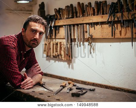 Carpenter working with tools in his carpentry