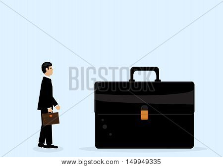 A businessman looking at a giant briefcase a metaphor on big business.