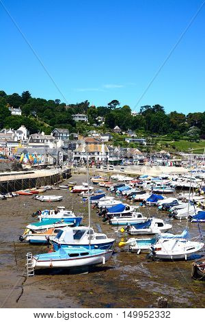 LYME REGIS, UNITED KINGDOM - JULY 18, 2016 - Boats and yachts moored in the harbour with views towards the town Lyme Regis Dorset England UK Western Europe, July 18, 2016.