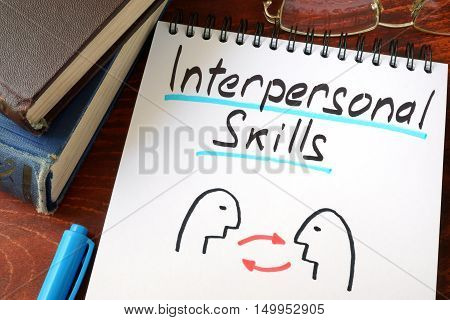Interpersonal Skills written in a paper with a glasses.