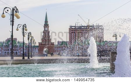background cityscape view of the bridge, Spassky tower and fountain in the center of Yoshkar-Ola, Mari El, Russia