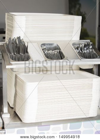 empty trays forks knife spoon station with nobody