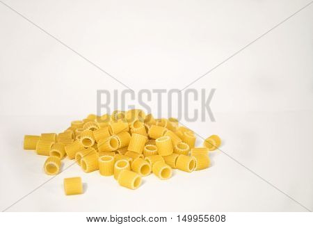 Raw italian pasta on a white background