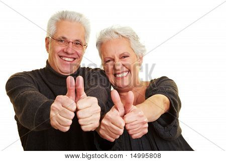 Happy Seniors Showing Thumbs Up