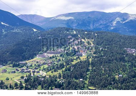 Picturesque top view of the mountain ridge and the houses in summer, Pyrenees, Girona, Alp, Catalonia, Spain