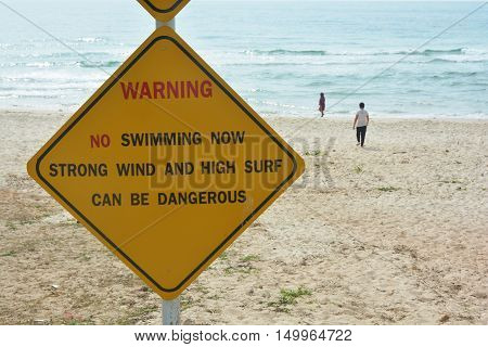 do not swimming sign with the beach