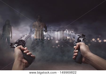 Man With Two Guns In His Hand Ready To Shooting A Lot Creepy Zombie