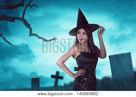 Gorgeous Asian Witch Woman Is Standing Looking His Back