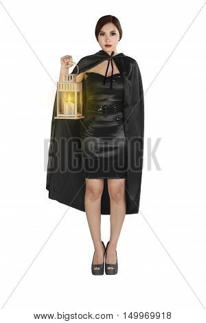 Young Asian Woman In A Witch Costume With Cloak Holding Lantern