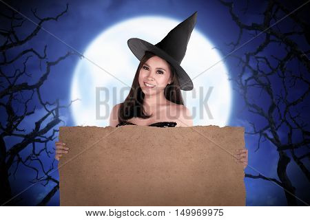 Halloween Asian Witch Holding Parchment Paper
