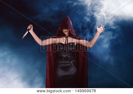 Murderer Asian Witch Woman With Red Cloak Holding Bloody Knife