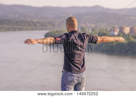 Back Rear View Freedom Man Standing High Above Arms Raised Up