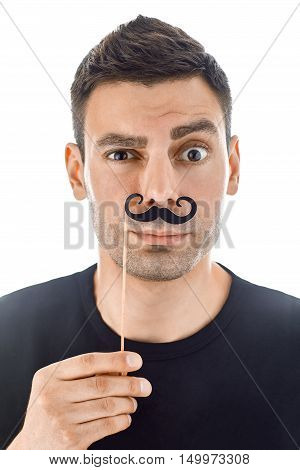 Young Man With Paper Moustaches Making Faces Isolated On White Background