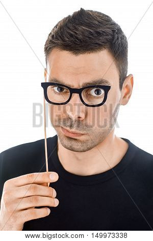 Young Handsome Man With Paper Glasses Making Faces
