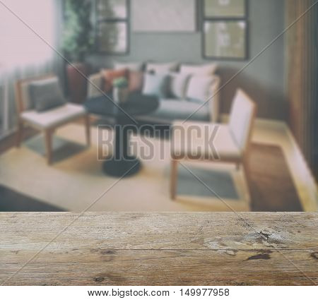 Wooden Table Top With Blur Of Simply Style Living Room Interior