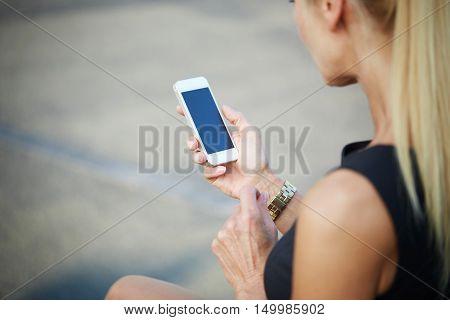 Portrait of unrecognizable woman using newest smartphone