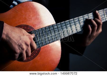 Guitar instrument. Musician or guitarist. Music musical sound. Finger hand on string. Acoustic concert closeup. Player play chord. Wood jazz rock performance. Fretboard.