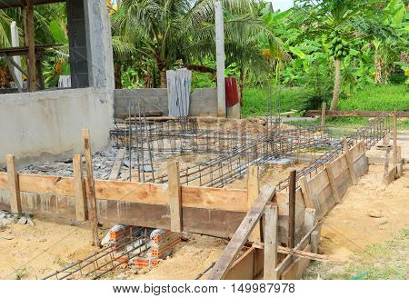 board forms and rebar for a block house addition, near Songkhla, Thailand