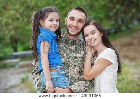 US army soldier with family in park