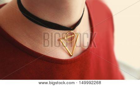 Close up of stylish black choker on female neck