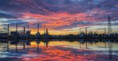 oil refinery industry plant along twilight morning. oil refinery industry reflection. oil refinery on beautiful sky. oil refinery produces gasoline. oil refinery in Bangkok Thailand. poster