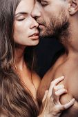 young sexy couple of woman or girl with pretty face and long hair embrace handsome muscular unshaven man with bare chest or breast on body poster