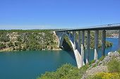 An inlet of the Adriatic Sea near Skradin in Sibenik-Knin County in Croatia. The E65 motorway can be seen passing over the inlet. poster