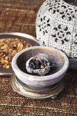 Myrrh is an aromatic resin, used for religious rites, incense and perfumes poster